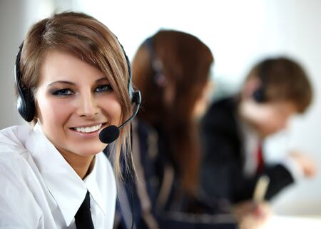 support desk: Beautiful representative smiling call center woman with headset. Stock Photo