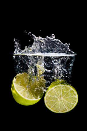 lemon water: Lemon splash on black background