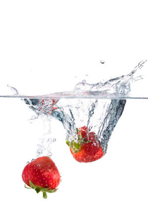 fruit in water: Strawberry splash on white
