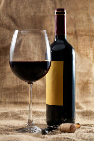 merlot: Red wine glass and bottle  Stock Photo