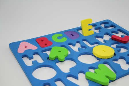 Educational foam alphabet puzzle isolated on white background