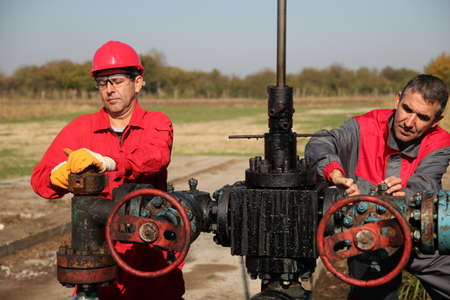 Two oil and gas engineers working on oil rig equipment