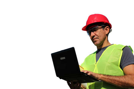 personal protective equipment: Engineer with personal protective equipment typing on the computer keyboard isolated over a white background  Stock Photo