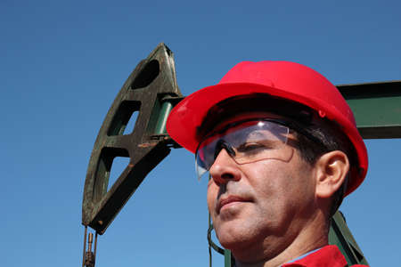pump jack: Portrait of petrochemical engineer at pump jack oil well.