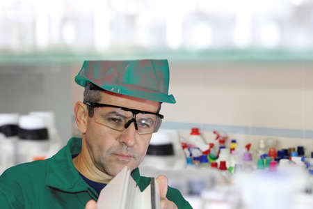 Focused quality control inspector examining part in laboratory