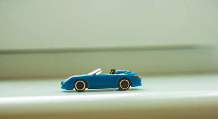 blue toy car on white background