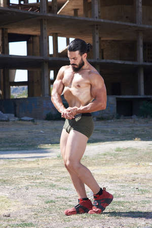muscular man doing body building exercises .