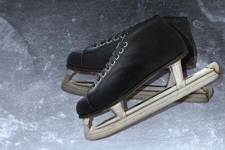 scuffed: Old hockey skates are on the ice. Vintage concept
