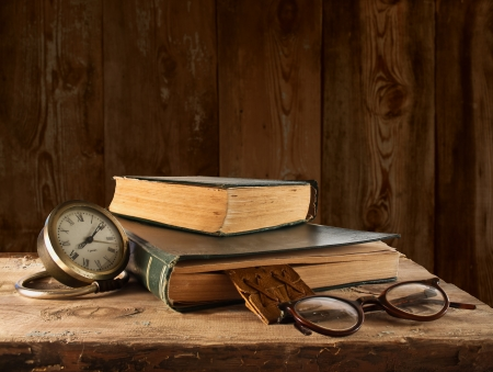 Vintage book, glasses and watches Stock Photo