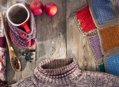 good weather: Winter composition with a mug of hot mulled wine, a sweater and a blanket
