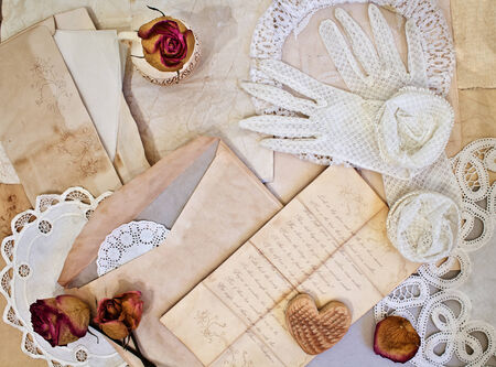 Womens white gloves and old letters. Shakespeares Sonnet on crumpled paper grange. Vintage collection photo