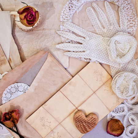 Womens white gloves and old letters. Vintage items photo
