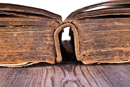 book binding: An old book on a wooden table.  Stock Photo