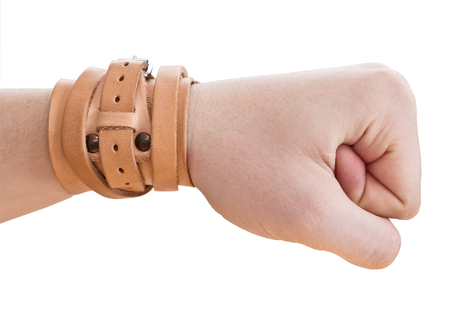 hand is clenched into a fist.  Wrist Band.  Stock Photo