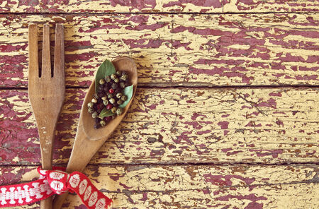 Wooden spoon and fork on wooden background