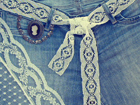 Denim background with lace and jewelry