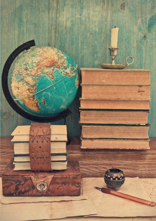 old books and globe photo