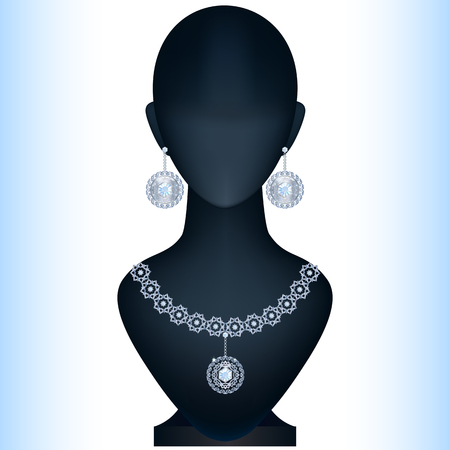 Mannequin with womens jewelery. Silver earrings and necklace with topaz