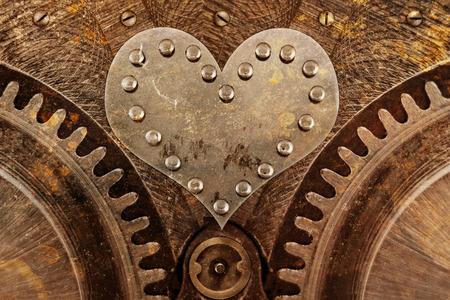 Grungy achtergrond met een metalen hart en klinknagels Stockfoto