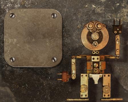 暗い汚れた背景と金属製のフレームに金属部品のロボット