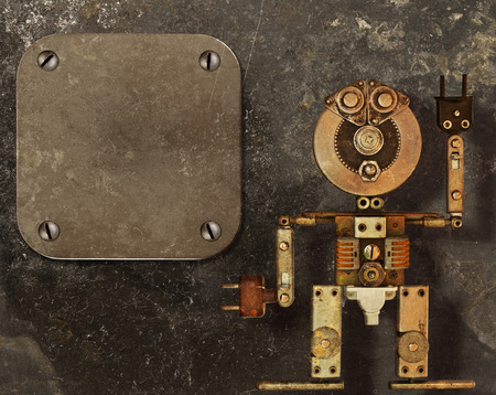 industrial machinery: Robot of the metal parts on a dark grungy background and metal frame
