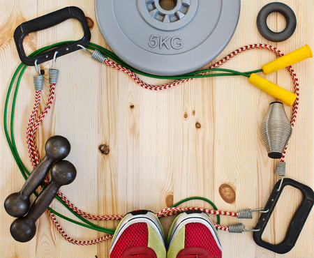 Frame with sports accessories and sneakers