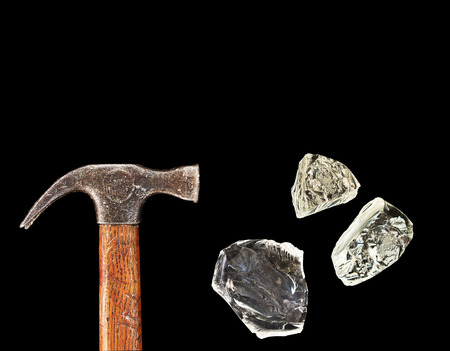 shards: Hammer and pieces of glass isolated on black background