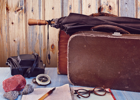Old suitcases and a camera. Set traveler. Retro concept photo