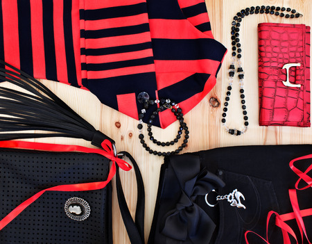 fashionable womens clothing and accessories in red and black tones