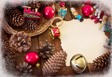 Christmas frame with Christmas decorations, pine cones and basket photo