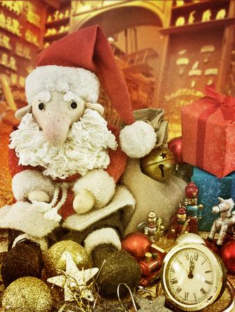 toy shop: Santa Claus sitting among antique toys next to the alarm. Toning. Vintage postcards. Imitation of Vintage
