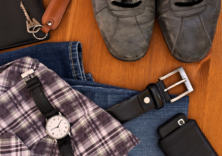men's clothing and accessories on a wooden background