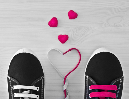 Sneakers with colorful laces. The idea of Valentines Day photo