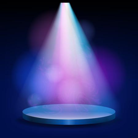 Światła: Pusta scena oświetlona światłami na niebieskim tle. Na podium świeci jasny reflektor