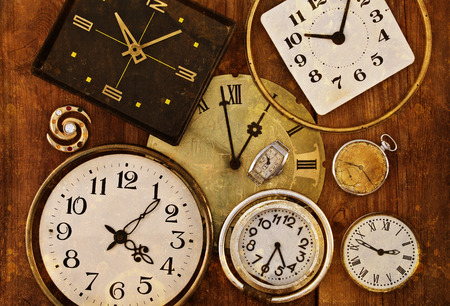 Old clock on a grungy background. Collection of vintage watches