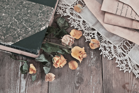 Vintage book and bouquet of dried roses
