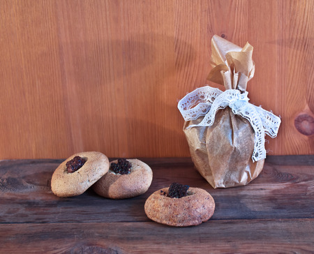 Homemade oatmeal cookies with a stuffing on a wooden background
