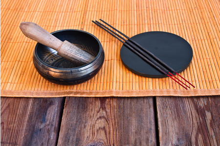 singing bowl: Tibetan singing bowl with its wooden mallet and incense sticks