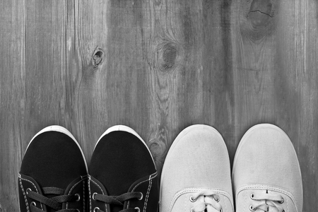 Male and female shoes on  vintage wooden background Stok Fotoğraf