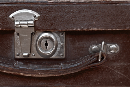 Close-up fragment of lock  on the vintage suitcase brown Stok Fotoğraf