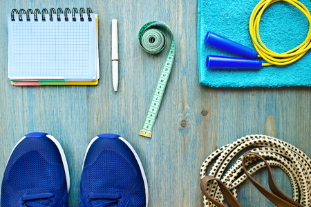 Accessories for the fitness classes on a blue wooden background