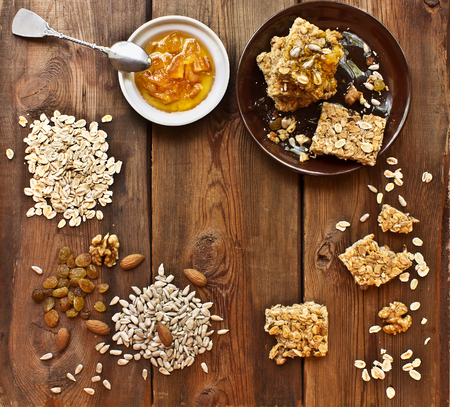 Homemade granola bars with ingredients and orange jam Stok Fotoğraf
