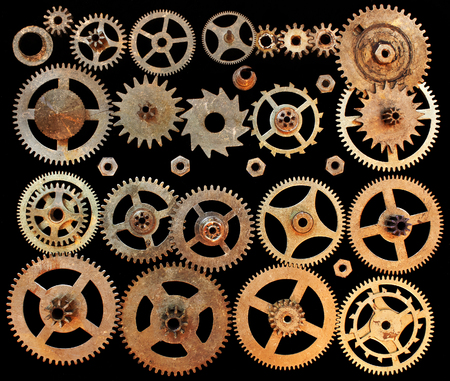 Mechanical cogs gears wheels isolated on a black background