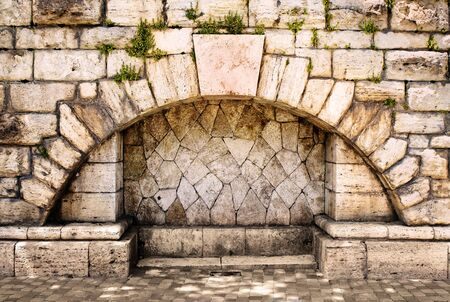 arch in the old stone wall