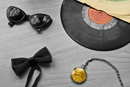 Vinyl records, a tie and the clock on the wooden table Stok Fotoğraf