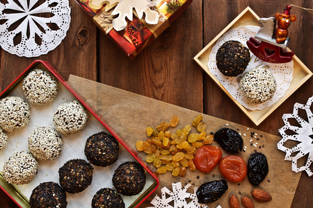 vegetarian foods. festive New Years table. homemade candy of dried apricots, raisins, nuts, prunes, sesame Stok Fotoğraf