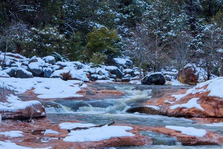 runoff: Icy stream in Sedona, Arizona swollen with runoff from melting snow.