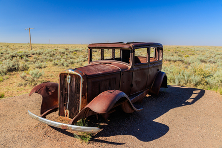 Ancient car alone in the Desert.
