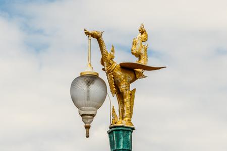 Golden ornamental dragon street light in Thailand