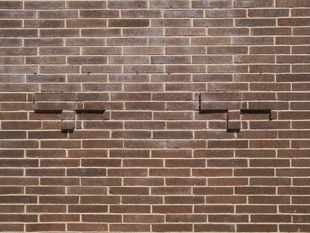 Stock photo of the texture of a dirty brick building.